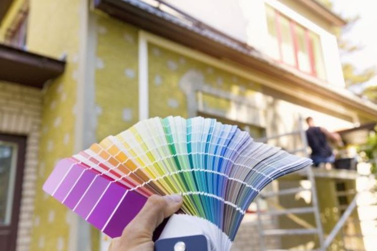 paint chip samples fanned out in front of home